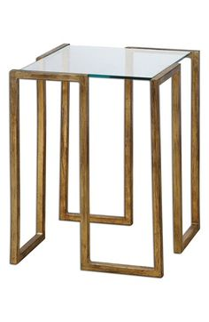 Free shipping and returns on Uttermost 'Mirrin' Antiqued Goldtone Glass Top Accent Table at Nordstrom.com. Hand-forged iron with an antiqued goldtone finish shapes a cool modern accent table fitted with a tempered-glass top.