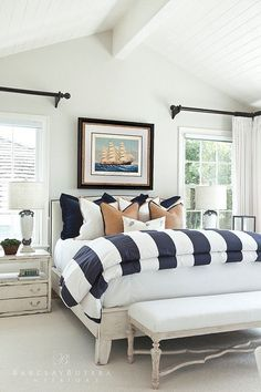 Bedroom decor ideas - Coastal Style, nautical inspired blue and white striped bed cover, painted rustic furniture, gold and black accents.