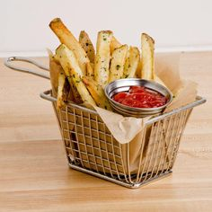 """For a unique product presentation, serve a variety of fried foods, side dishes, appetizers, or entrees in this distinctive 4"""" rectangular stainless steel fry basket. Each basket looks exactly like their kitchen counterparts, but at a fraction of the size. They are perfect for contemporary or themed restaurants, bars, or delis. <br><br><b><u>Overall Dimensions:</b></u> <br>Length: 4"""" <br>Width: 3"""" <br>Height: 3&quot..."""
