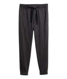 Suit-style jogger pants in satin-weave stretch cotton fabric. Side-seam pockets, elasticized drawstring waistband, hook-and-eye fastener, and welt back pockets. Narrow stripes along outer legs.