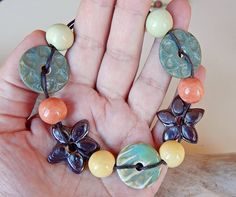 11 pieces ceramic and porcelain . 6 Beads made of ceramic . 5 spacers shaped flower made of porcelain . By Mª Carmen Rodriguez  https://www.facebook.com/groups/CeramicArtBeadMarket