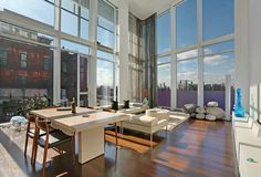 165 Charles Street, Apt. 1, West Village, Manhattan: Iconic and modernist Richard Meier home in the desirable far West Village. This lofty apartment is one of only three apartments in the building with a soaring double-height living room overlooking the Hudson River. South and west exposures provide exceptional sunlight and sweeping park and river views.