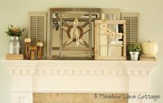 Mantel decor with empty frames and banners/signs