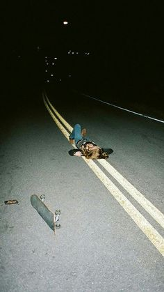 Lying in the street, skateboard, indie, rebel, teenager.