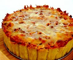 Pasta Pie    Serves: 8  Ingredients    1 pound Rigatoni  2 Tablespoons Olive oil, divided  1 pound Ground beef (I used ground sirloin)  2 Garlic gloves, crushed  1/4 teaspoon Freshly ground pepper  1 can (28 ounces) Good quality crushed tomatoes  Butter, for pan  Salt  1 cup Parmesan cheese, finely grated  8 ounces Coarsely grated mozzarella cheese