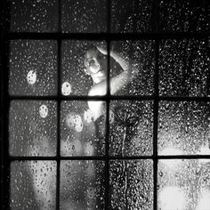 I like how she is obviously someone important, the way the window is, her hair, the dress. It's all simply put into one thing. Words: Beautiful, rain, cold, rich, important, exciting, dress, hair, arm.