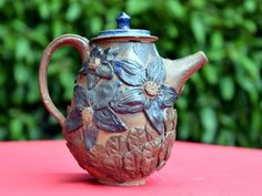 The Tall Teapot - By Earthifacts as part of their garden series. Available for Rs. 4,500 at http://www.worldartcommunity.com/items/the-tall-teapot/