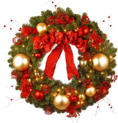 The 36 Cozy Christmas Wreath from the National Tree Decorative Collection is trimmed with a red bow, berries and gold and red ball ornaments. This delightful holiday decoration is pre-strung with 100 red and clear lights for hanging indoors or outdoors. Pre Lit Wreath, Christmas Wreaths With Lights, Diy Christmas Decorations For Home, Artificial Christmas Wreaths, Cozy Christmas, Holiday Wreaths, Holiday Decorating, Decorating Ideas, Canada Christmas