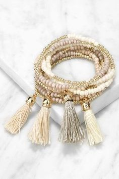 The Talkin' Tassels Gold and Taupe Bracelet Set is sure to quickly become an outfit staple! Nine bracelets boast an assortment of taupe, ivory, and gold beads, plus tassel accents. Tassel Bracelet, Tassel Jewelry, Bracelet Set, Beaded Jewelry, Jewelry Bracelets, Pandora Bracelets, Diamond Bracelets, Chain Bracelets, Amber Jewelry