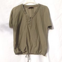 ❗FINAL PRICE❗Olive Green Loft Ann Taylor Top Silk and cotton olive green top. Has a tie at bottom, as well as buttons on each sleeve, which can be undone. Great condition, very lightweight. LOFT Tops Blouses