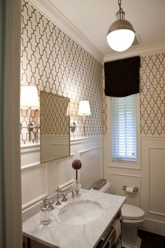 Classic bath with trellis paper, marble, nickel sconces, and Thomas O'brien pendant.