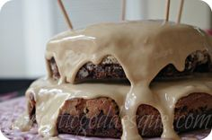 brownie and vanilla sponge layer cake with caramel frosting