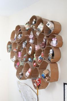 Cardboard Could be an interesting way to display a collection of found objects or nature objects.