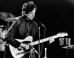 Singer Bob Dylan strums his guitar to the delight of over 17,000 fans who filled the Nassau Veterans Memorial Coliseum in Uniondale, NY. Dylan,accompanied by the Band , stopped at the New York suburb during their current six-week tour throughout the U.S. and Canada. (Jan. 29, 1974) Photo Credit: AP