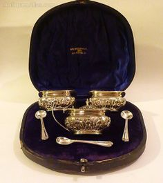 The most beautiful cased Edwardian silver condiment set in superb condition with the original blue liners & spoons.  An absolute delight to handle!  The whole set is fully hallmarked & made by Walker & Hall.