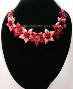 Leather flower necklace.