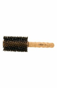 Ibiza G4 Hair Brush: A large round brush with swirled bristles for body and smoothness. For regular to coarse hair.