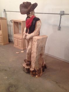 Chainsaw carved cowboy made by Joe Friend.