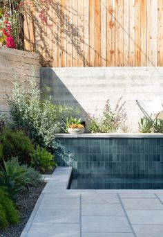 Visit: Spanish Colonial-Style Made Modern in LA One raised side of the pool is tiled in Heath's field tile in Heron Blue. Above it: a desert garden.One raised side of the pool is tiled in Heath's field tile in Heron Blue. Above it: a desert garden. Spanish Pool, Spanish Modern, Spanish Colonial, Spanish Revival, Heath Ceramics Tile, Heath Tile, Spanish Landscaping, Pool Landscaping, My Pool