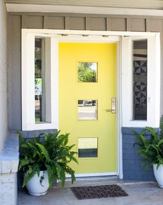 modern bright yellow front door // DIY door using a Crestview Doors light kit and a solid wood door from @homedepot #exterior