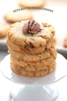 Titled image of a stack of keto butter pecan cookies on a cupcake stand. Sugar Free Pecan Pie, Sugar Free Desserts, Gluten Free Desserts, Dessert Recipes, Keto Desserts, Pecan Cookie Recipes, Butter Pecan Cookies, Keto Cookies, Low Carb Deserts