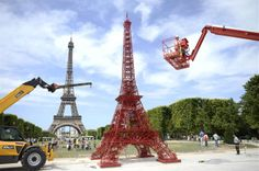 """Image: A replica Eiffel Tower made of Fermob """"Bistro"""" chairs"""
