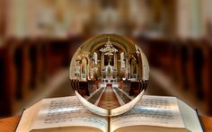 beautiful photo of the interior of a church reflected in a bauble