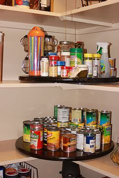 lazy susan in pantry corners. ~ If you look close you can see these are screwed to the shelf so they won't fall. Still spin though :)