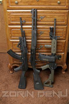 An AK, AR, & Semi Auto shotty