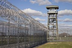 Prison Fence Watch Tower And Barbed Photograph Abandoned Prisons, Abandoned Places, Wall Exterior, Trump Tower, Fortification, U.s. States, Ecology, Outdoor Structures, Wire Fence