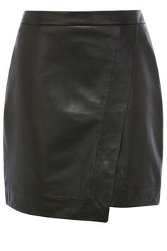 We're lusting after this perfectly cut leather mini skirt with it's new season asymmetric wrap feature. The piece has a high waist line and stitching detail to emphasise the wrap shape. The skirt is finished on the reverse with a concealed zip fastening. £75