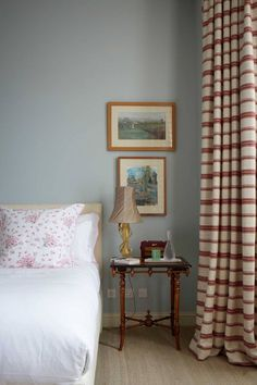"""In the main bedroom of Rita Konig's London flat she has used 'acres of C & C Milano wool' for generous curtains, and Farrow & Ball 'Skylight' for the walls, """"Farrow and Ball paint colours in real homes,"""" House & Garden. Farrow Ball, Farrow And Ball Paint, How To Dress A Bed, How To Make Bed, Interior Paint Colors, Home Interior Design, Paint Colours, Blue Bedroom, Bedroom Wall"""