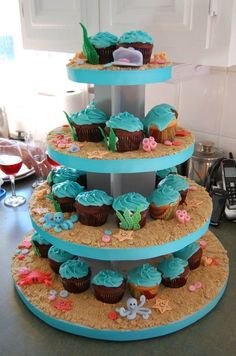 Now deciding what frosting I like best before sat!!!! Grad party under the sea cupcakes