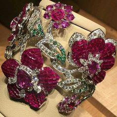 Le Secret high jewellery new collection by Van Cleef & Arpels ~ Mystery Set ruby, emerald and diamond bracelet.