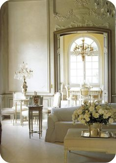 I absolutely love the fresco work on the walls of this living room.  The moldings are gorgeous.