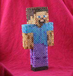 Minecraft Steve Figure Made of Perler Beads. Minecraft Perler, Hama Beads Minecraft, Diy Perler Beads, Minecraft Houses, Hama Beads Design, Peler Beads, Minecraft Birthday Party, Perler Patterns, Fuse Beads