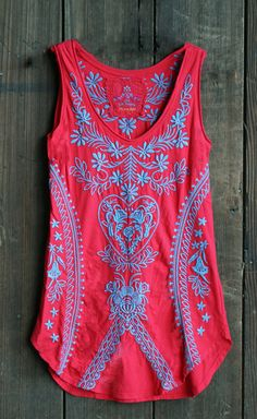 Beautifully embroidered in ocean blue on a rich marischino red shirt tail tank tunic.(http://www.acowgirlspromise.com/johnny-was-shirt-tail-embroidered-tank-tunic-marischino-red-blue/)