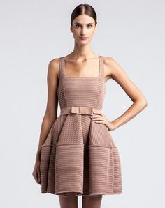 Lanvin dress with puffed skirt in beige techno netting and elastic knot belt.