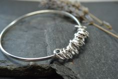 Bangle with ring charms £60.00