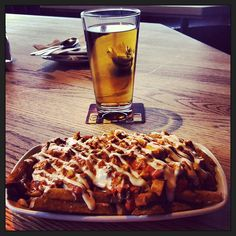 Photo by travelstacey - Incredible butter chicken poutine and a beer at Original Joes after a long hike. Aaaah! #ojsmenu #foodporn