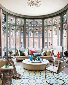 I might choose some different furniture, but I just can't not be in love with those windows!!