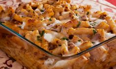 Quick and easy Baked Ziti recipe - This baked ziti recipe uses a blend of three cheeses to make it gooey and absolutely delicious. It is easy to make, serve with a salad and buttered crusty Italian bread for a hearty meal.