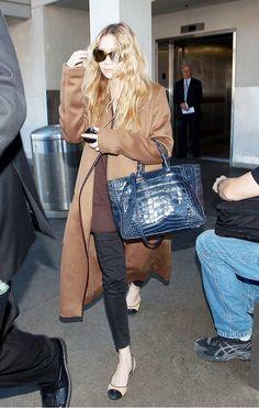 Ashley Olsen braves cold weather in an oversized camel coat.