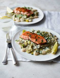 These pan-fried salmon fillets are served on a bed of creamy leeks and butter beans. A speedy gluten-free midweek meal, ready in 20 minutes Leek Recipes, Baked Salmon Recipes, Fish Recipes, Seafood Recipes, Cooking Recipes, Healthy Recipes, Salmon And Leeks Recipe, Salmon Recepies, Healthy Foods