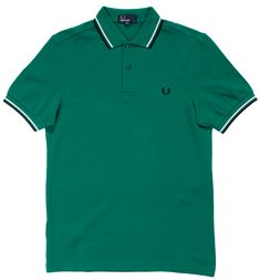 Stand out in this Fred Perry classic! This pitch green pique polo has contrasting navy blue & white stripes on the collar and sleeves with Laurel Wreath embroidery on the chest in navy. The offers a fit comparable to the but with slightly slimme Printed Polo Shirts, Short Sleeve Polo Shirts, Shirt Clips, Wreath Drawing, Twin Tips, Wool Berets, Laurel Wreath, Wreath Watercolor, Dress Up Costumes