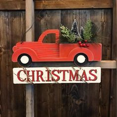 Nothing says Christmas on the Farm like this adorable red farm truck hanger. hangs on a wire and has berries, little tress and greenery on it! Seriously one of