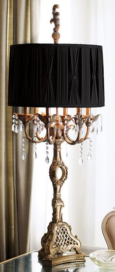 Updated version of the traditional English Country black lamp-shaded table light.