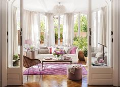 Lounge decorated in pinks and white