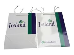Gloss laminated paper event bag with branding and white rope handles