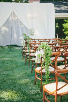 greenery draped over bentwood chairs overlooking this backyard #ceremony Photography: onelove photography - onelove-photo.com, Design and Styling by http://www.sugarrushevents.com, Florals by http://theflowerhouse.com/  Read More: http://stylemepretty.com/2013/10/03/classic-backyard-wedding-from-onelove-photography/